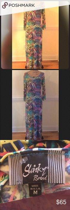"""Slinky Brand M Knit Maxi Dress Fireworks Print New Here is a lovely dress in size Medium by Slinky Brand. This is absolutely gorgeous but still comfortable because it's made of Slinky's exclusive micro-ribbed acetate knit fabric. The print looks like fireworks in bright colors. Measures Approximately Bust: 40"""", Waist: 35"""", Hip: 40"""", Sleeve length: 19"""", Length from shoulder to hem: 52"""".  Brand new. The paper tag was lost but the fastener remains. Slinky Brand Dresses Maxi"""