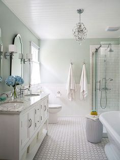 It's time to ditch the myth that spa-like bathrooms are only for ritzy hotels. You can easily create your own calming oasis by employing a few intentional techniques. From cool color schemes to tantalizing textural themes, these 12 stylish spaces serve as proof that a calming bath is within your grasp.