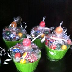 Cupcake Party Favors.  Made these for Landon's first birthday!  Found the green holders at Hobby Lobby, filled with candy, and put a sucker through and tied with a ribbon.  So cute and fun!