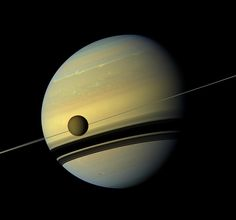 Stunning image of Saturn and Titan by NASA Cassini probe.