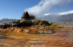 Fly Geyser, Gerlach, Nevada- A geyser that was triggered by drilling for a water well.  The initial geyser/well has died, but this new one sprung up not far away. (photo by Michael Flick, on Flickr; linked in article (CC BY-NC 2.0))
