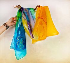 Check out this item in my Etsy shop https://www.etsy.com/listing/193553013/hand-painted-rainbow-silk-scarf-sun