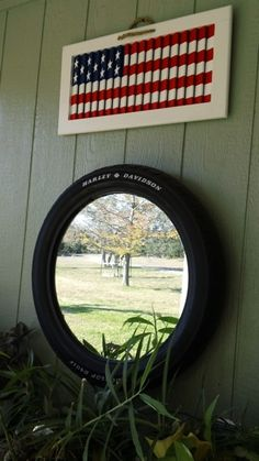 Flag made out of old shutter and mirror framed with a Harley-Davidson tire repurposed Garden July Crafts, Summer Crafts, Holiday Crafts, Fourth Of July Decor, 4th Of July Decorations, July 4th, Harley Davidson Tires, Diy Shutters, Repurposed Shutters