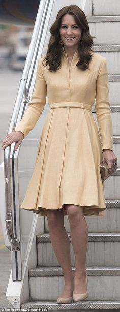 Dressed in a gold coat dress, Kate looked every inch the radiant royal as she stepped off the private plane in Bhutan this morning