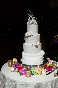 Minimalistic & feminine 4-tier wedding cake with floral details, silver cake tray, & tea light candle accents // jpband.com