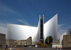 Swooping steel-clad walls support the cross-shaped roof window of Kenzo Tange's 1960s St Mary's Cathedral in Tokyo.