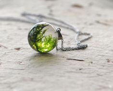 Real moss globe necklace - unique woodland crystal resin orb ball - stainless steel chain by UralNature on Etsy https://www.etsy.com/listing/123885650/real-moss-globe-necklace-unique-woodland