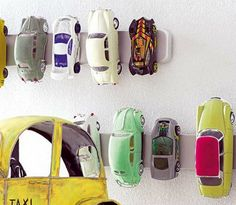 Genius. Magnetic strips from IKEA. For all the cars and trains we have around the house! FOR YOU TAI