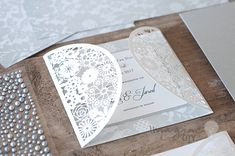 small laser cut invitation to decorate yourself. Floral laser cut wedding stationery blanks