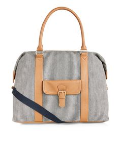 Designed with leather-look trims, our sailor stripe weekender bag has ample space for mini break essentials, plus an additional front pocket for smaller items. Carry it in hand or use the detachable and adjustable shoulder strap.