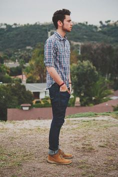 Shop this look on Lookastic: https://lookastic.com/men/looks/white-and-red-and-navy-long-sleeve-shirt-navy-skinny-jeans-tobacco-desert-boots/18091 — White and Red and Navy Plaid Long Sleeve Shirt — Red Bracelet — Navy Skinny Jeans — Tobacco Suede Desert Boots