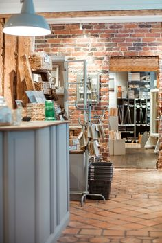 Our counter and a beautiful old brick wall / Myyntitiski ja upea vanha tiiliseinä Old Brick Wall, Old Bricks, Counter, Store, Furniture, Beautiful, Home Decor, Decoration Home, Room Decor