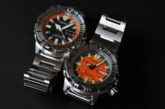 Seiko Monster gen 1 diving watches, Face off mod are switched between orange and black face paint. It is very rare watches.