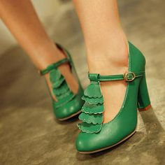 green leather t-strap heels with [scalloped with eyelet detail] ruffles down the front - come in blush + nude too!!!! Adorbzzz overload + for JUST $40?!  --- I can't stand it....
