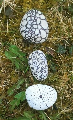 small stones painted with a black waterproof marker pen