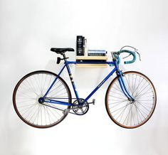 {bike rack} doubles as a shelf! make your bike a piece of art. :)