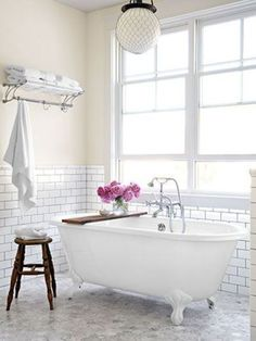 subway tile at chair rail height, carrara floor (maybe hex, penny round or chevron)