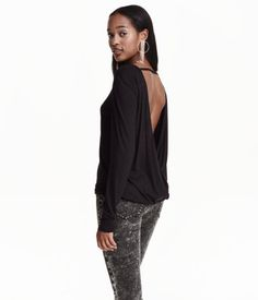 Long-sleeved top in soft viscose jersey with a sheen. Low-cut, wrap-style back with horizontal strap across back of neck. Elasticized hem.