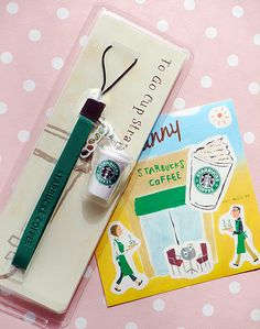 Starbucks Coffee Japan To Go Cup Mobile Phone Strap with a plastic Starbucks cup.