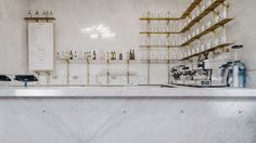 Australian studio Biasol has designed a marble interior for this espresso and cocktail bar in the historic Royal Exchange building in London.