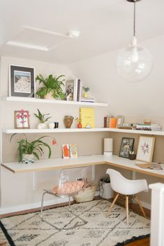 North of South and East of West, an oasis of warmth and style in Minneapolis - corner wall shelving as a desk