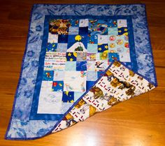 Baby quilt. Made by Mary Paterson. From Mary and Tony.