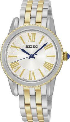 Seiko Dameshorloge SRZ438P1. Kaliber 7N01. Een bijzonder mooi vormgegeven horloge. Een goud- en zilverkleurige band en kast en een creme-kleurige wijzerplaat. De kastrand is voorzien van een soort pareltjes-patroon. Het horloge weegt 70 gram, heeft dat harde Hardlex glas en is 50 meter waterdicht. Voor de finishing touch heeft het horloge een Cabochon knop. Trendy en elegant model uit de Seiko collectie.