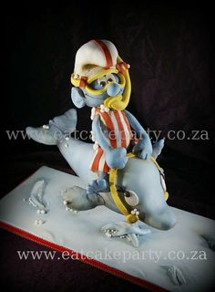 Smurf on a dolphin - by DotKlerck @ CakesDecor.com - cake decorating website