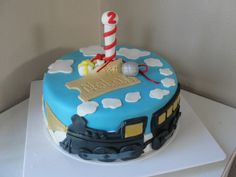 Another cute Polar Express cake. I would take off the clouds and replace with snowflakes.