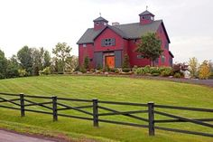Barn Red Exterior | The Somerset Post and Beam Barn Home rustic-exterior