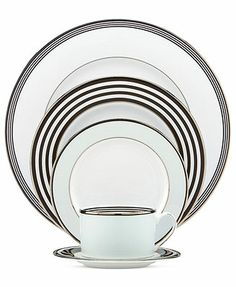 With the bands. Graphic and modern, the Parker Place place setting creates instant ambiance with rings of platinum, black and pale blue. Variation from piece to piece adds a playful sensibility to sle