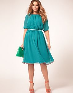 Midi plus size dress by ASOS CURVE. Crafted in a lightweight, semi sheer chiffon fabric. Featuring a boat neckline with a contrast bound edge, cropped sleeves with fitted cuffs, seam detailing, a high, fitted waist, soft pleating to the skirt and a keyhole button fastening to the reverse.