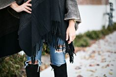 Black and tan poncho. Fall style. Street Style  Www.thecollaborationblog.com Poncho > @ Stitch Boutique A Piece of Me Jeans> @ Inspyre Boutique  Toro Boots > @ Inspyre Boutique Gold Watch > @ Michael Kors Gold stackable rings > @ Inspyre Boutique