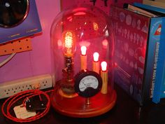 Here is another light by The Steampunk Lamp Factory. This one I found on ebay. Way cool and so detailed. Red cloth wire on the plug and everything! Awesome Steampunk Art!