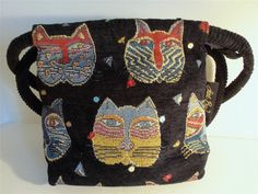 Who doesn't love Laurel Burch!  Anyone seeing this handbag will know the design and the beautiful colors go with everything