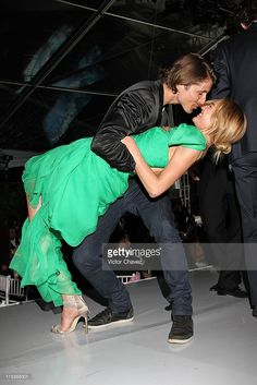 Top Model Candice Swanepoel and her boyfriend Hermann Nicoli dance on the stage during the Gala Moda Nextel Mexico City 2011 party at the Plaza de Toros on June 4, 2011 in Mexico City, Mexico.