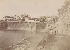 A very rare antique b&w photo laid on board of Casablanca and the sea wall at San Juan, Puerto Rico.  Taken by the U.S. invading forces after the Spanish-American war of 1898.