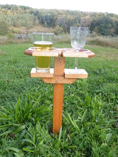 Beer Holder - Wine Holder - Drink Holder, Beer, Wine or Soda/Pop  This unique stand is great for those that love the outdoors, and love to drink beer or wine. It solves the problem of where to set your drink without spilling it. The stand will hold two beers, wine glasses, bottles, or even red solo cups or any combination of two. A very multi-purpose stand indeed. Item is 16 tall, 12 wide and 8 deep. Covered with a clear polyurethane coating. Wine, Beer and Glasses are not included. The…