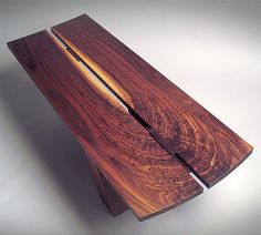 Cantilevered Coffee Table - Dave Boykin  Furniture designers Boykin and Pearce (the latter now retired) knew the book-matched walnut boards used for this cantilevered coffee table were special when they first laid eyes on them. So they bought them, right away.