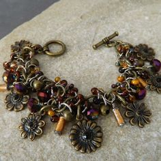Purple and Gold Charm Bracelet by WireNWhimsy on Etsy