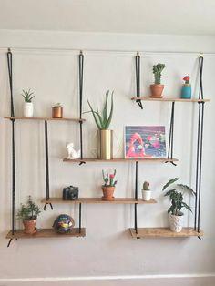 Black Rope Suspended Shelves by WildJungleLeaves on Etsy https://www.etsy.com/listing/541124097/black-rope-suspended-shelves