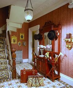 Complete with tiny paintings on the walls, flowers in a vase and suitcases packed and ready to go, this is the stunning entrance hall to José Alesón's Victorian doll's house.