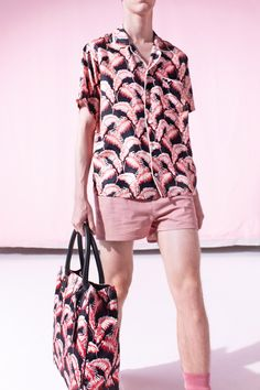 Marc Jacobs Spring-Summer 2015 Men's Collection. You have to be kidding me! What are those figures on his shirt? Pink shrimp?