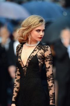 British model Cara Delevingne in Burberry attends the Opening Ceremony and 'The Great Gatsby' Premiere during the Annual Cannes Film Festival, 15 May 2013.
