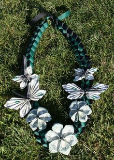"""Money Lei """"Flowers"""" (Black & Green) for Graduation. Photo only looks. Like according butterfly and six petal plumeria origami? Money Lei, Money Origami, Money Rose, Creative Money Gifts, Cool Gifts, Diy Gifts, Graduation Leis, Preschool Graduation, Graduation Necklace"""
