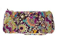 Fabric Vera Bradley Large Duffel has top zip closure with 1 exterior side slippocket; Dual handles with drop of approx. 16 inches - Interior features spacious open compartment that is lined with quilt
