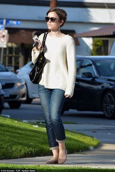 'Kicking off birthday month': Lily Collins out and about in Hollywood in a classic cream jumper and jeans as she prepares to turn 26