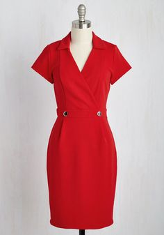 Poise yourself as being the most polished employee in the office each time you sport this red, collared dress. A surplice neckline, princess seams, and decorative buttons at the waist collaborate to create a retro, professional look!