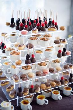 dessert display with cake pops, eclairs, macaroons, and mini pies