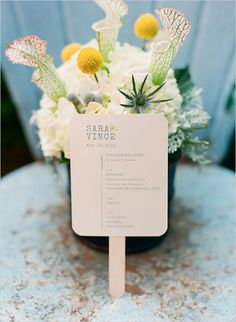 match the design of the invitation and attach to a popsicle stick for a double-duty fan and wedding program!